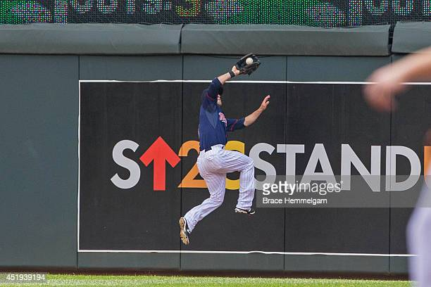 Sam Fuld of the Minnesota Twins fields against the New York Yankees on July 6 2014 at Target Field in Minneapolis Minnesota The Yankees defeated the...