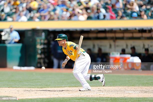 Sam Fuld of the Oakland Athletics bunts during the game against the Seattle Mariners at Oco Coliseum on July 5 2015 in Oakland California The...