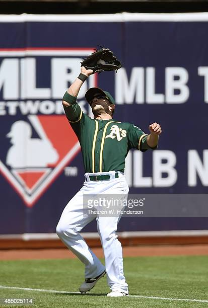 Sam Fuld of the Oakland Athletics catches a fly ball off the bat of James Loney of the Tampa Bay Rays in the top of the second inning at Oco Coliseum...