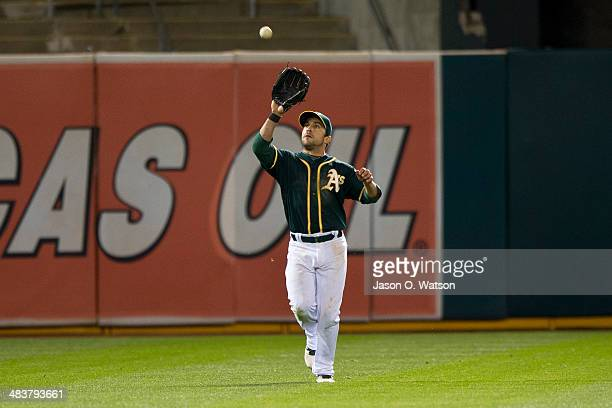 Sam Fuld of the Oakland Athletics fields a fly ball hit off the bat of Mike Zunino of the Seattle Mariners during the twelfth inning at Oco Coliseum...