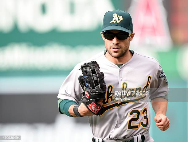 Sam Fuld of the Oakland Athletics heads into the dugout at the end of the fifth inning at Angel Stadium of Anaheim on April 23 2015 in Anaheim...