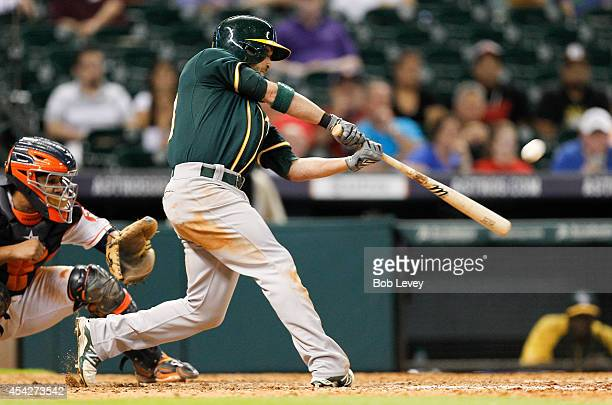Sam Fuld of the Oakland Athletics hits a tworun home run in the ninth inning against the Houston Astros at Minute Maid Park on August 27 2014 in...