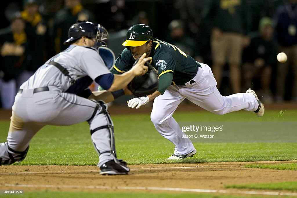 Sam Fuld #29 of the Oakland Athletics is tagged out at home plate by <a gi-track='captionPersonalityLinkClicked' href=/galleries/search?phrase=Mike+Zunino&family=editorial&specificpeople=6803368 ng-click='$event.stopPropagation()'>Mike Zunino</a> #3 of the Seattle Mariners attempting to extend a triple into an in the park home run during the fifth inning at O.co Coliseum on April 3, 2014 in Oakland, California.