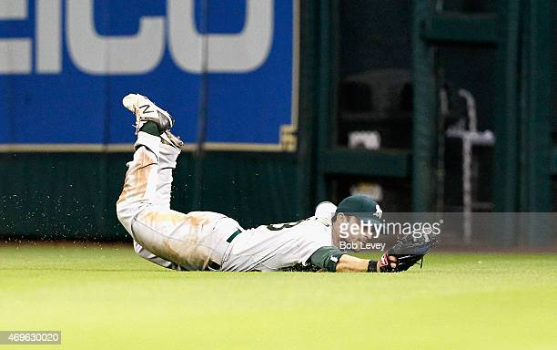 Sam Fuld of the Oakland Athletics makes a diving catch on a line drive in the fifth inning by Jake Marisnick of the Houston Astros at Minute Maid...