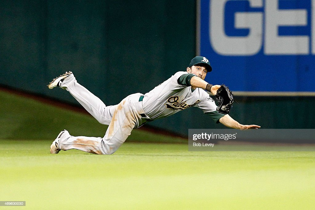 <a gi-track='captionPersonalityLinkClicked' href=/galleries/search?phrase=Sam+Fuld&family=editorial&specificpeople=4505687 ng-click='$event.stopPropagation()'>Sam Fuld</a> #23 of the Oakland Athletics makes a diving catch on a line drive in the fifth inning by Jake Marisnick #6 of the Houston Astros at Minute Maid Park on April 13, 2015 in Houston, Texas.
