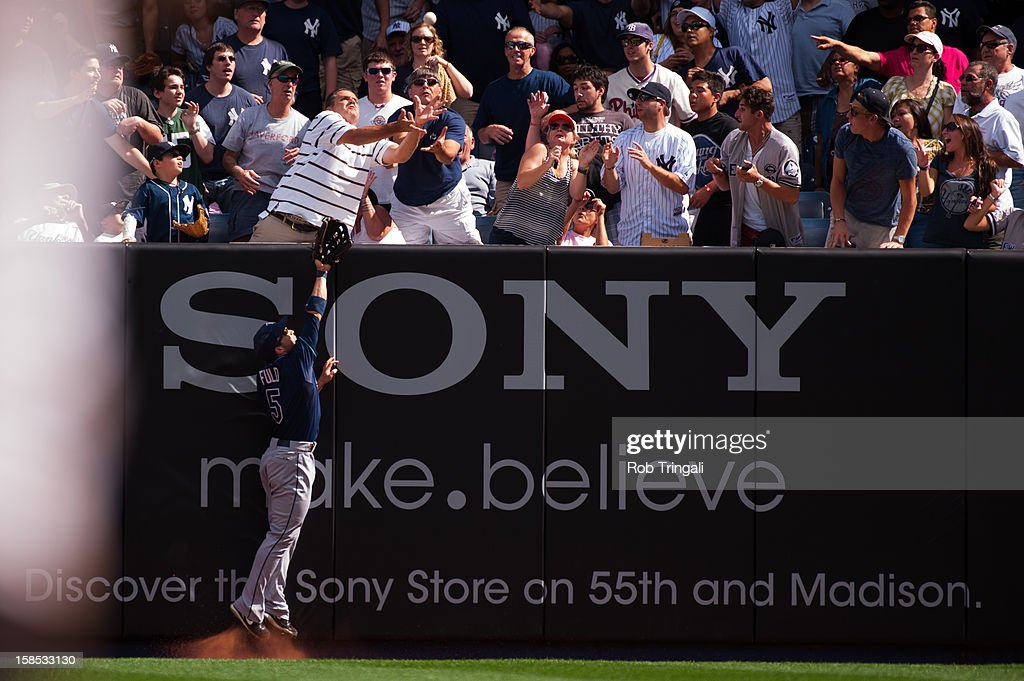Sam Fuld #5 of the Tampa Bay Rays attempts to make a catch a 3-run home run by Russell Martin #55 of the New York Yankees in the bottom of the third inning on September 16, 2012 at Yankee Stadium in the Bronx borough of New York City. The Yankees won the game 6-4.