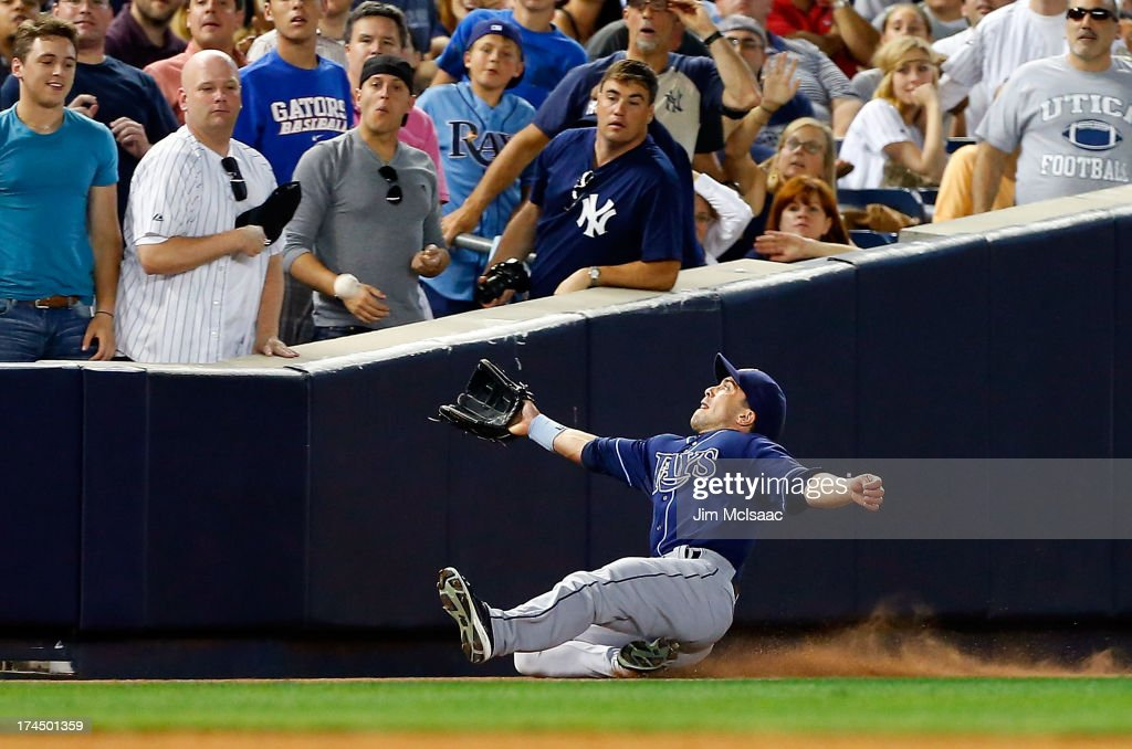 <a gi-track='captionPersonalityLinkClicked' href=/galleries/search?phrase=Sam+Fuld&family=editorial&specificpeople=4505687 ng-click='$event.stopPropagation()'>Sam Fuld</a> #5 of the Tampa Bay Rays attempts to make a catch on a fifth-inning foul ball off the bat of Robinson Cano (not pictured) of the New York Yankees at Yankee Stadium on July 26, 2013 in the Bronx borough of New York City.