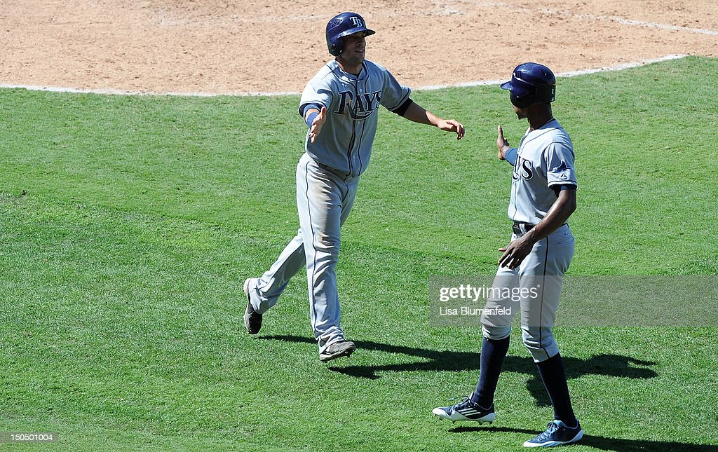 Sam Fuld #5 of the Tampa Bay Rays celebrates with teammate B.J. Upton #2 after scoring in the ninth inning against the Los Angeles Angels of Anaheim at Angel Stadium of Anaheim on August 19, 2012 in Anaheim, California.