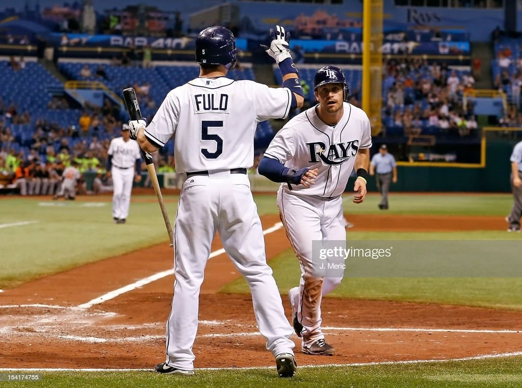 Sam Fuld #5 of the Tampa Bay Rays congratulates Evan Longoria #3 after scoring against the Baltimore Orioles during the game at Tropicana Field on October 1, 2012 in St. Petersburg, Florida.