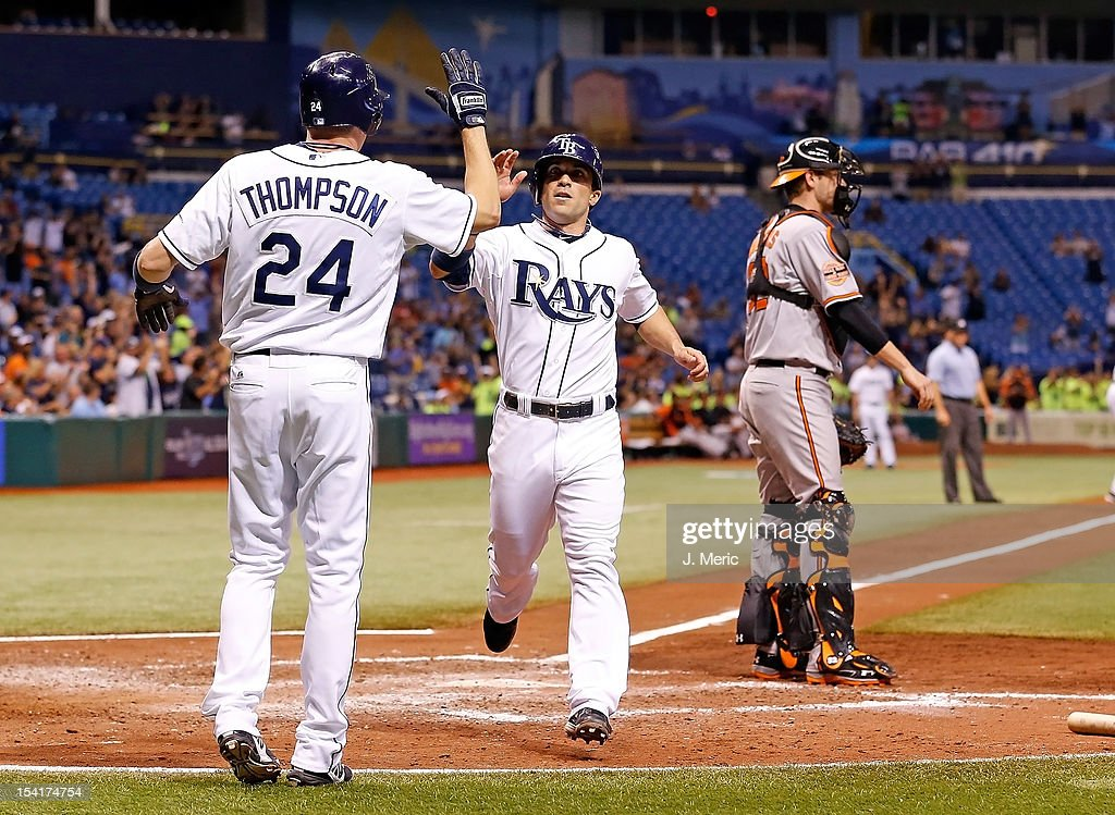 Sam Fuld #5 of the Tampa Bay Rays is congratulated after scoring against the Baltimore Orioles during the game at Tropicana Field on October 1, 2012 in St. Petersburg, Florida.