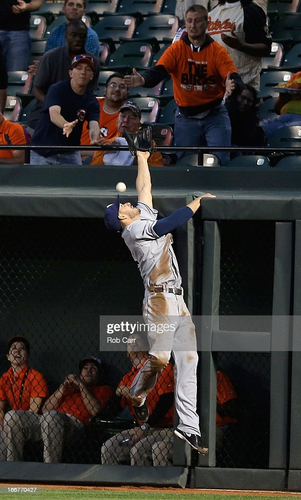 <a gi-track='captionPersonalityLinkClicked' href=/galleries/search?phrase=Sam+Fuld&family=editorial&specificpeople=4505687 ng-click='$event.stopPropagation()'>Sam Fuld</a> #5 of the Tampa Bay Rays misses catching a solo home run hit by Matt Wieters #32 of the Baltimore Orioles (not pictured) during the second inning at Oriole Park at Camden Yards on April 16, 2013 in Baltimore, Maryland.