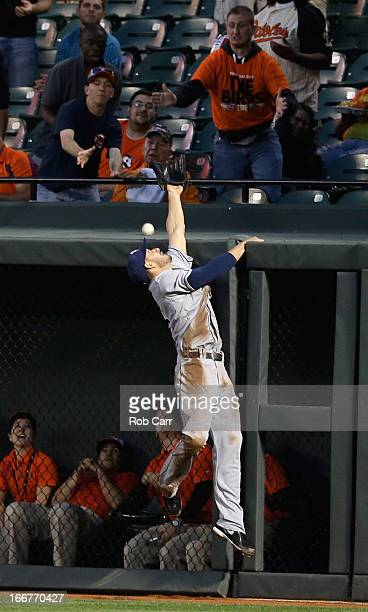 Sam Fuld of the Tampa Bay Rays misses catching a solo home run hit by Matt Wieters of the Baltimore Orioles during the second inning at Oriole Park...
