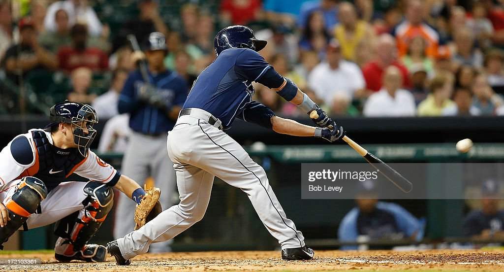 Sam Fuld #5 of the Tampa Bay Rays singles in a run in the fifth inning against the Houston Astros at Minute Maid Park on July 1, 2013 in Houston, Texas.