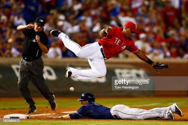 Sam Fuld of the Tampa Bay Rays steals third base against Adrian Beltre of the Texas Rangers in the ninth inning during the American League Wild Card...