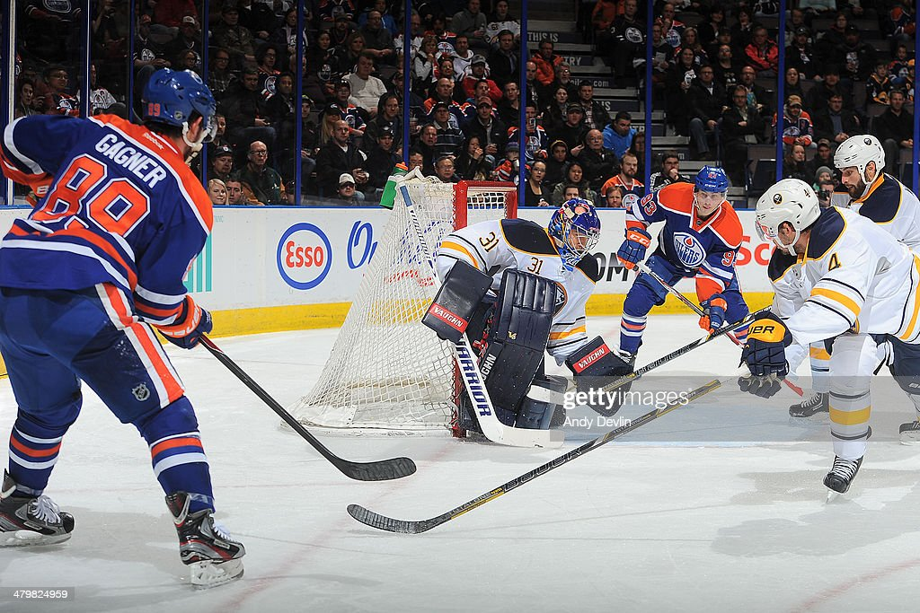 Sam Gagner #89 and Ryan Nugent-Hopkins #93 of the Edmonton Oilers attack the net as Matt Hackett #31 of the Buffalo Sabres makes a save on March 20, 2014 at Rexall Place in Edmonton, Alberta, Canada.