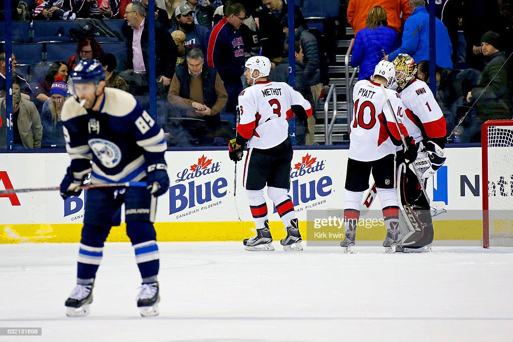 Sam Gagner #89 of the Columbus Blue Jackets skates off of the ice as Tom Pyatt #10 of the Ottawa Senators congratulates Mike Condon #1 of the Ottawa Senators after defeating the Columbus Blue Jackets 2-0 on January 19, 2017 at Nationwide Arena in Columbus, Ohio.