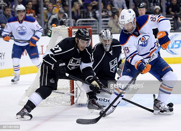 Sam Gagner of the Edmonton Oilers attempts a shot as he is followed by Alec Martinez of the Los Angeles Kings in front of Martin Jones of the Los...
