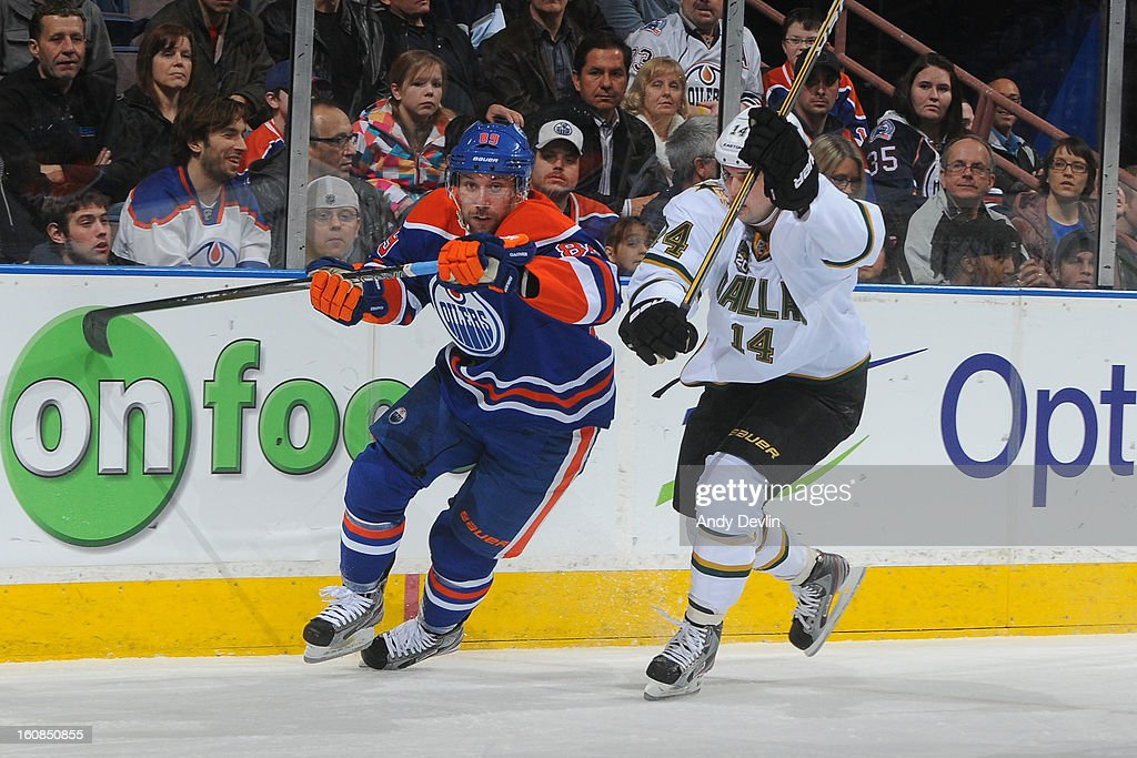 <a gi-track='captionPersonalityLinkClicked' href=/galleries/search?phrase=Sam+Gagner&family=editorial&specificpeople=4042961 ng-click='$event.stopPropagation()'>Sam Gagner</a> #89 of the Edmonton Oilers battles for position against <a gi-track='captionPersonalityLinkClicked' href=/galleries/search?phrase=Jamie+Benn&family=editorial&specificpeople=4595070 ng-click='$event.stopPropagation()'>Jamie Benn</a> #14 the Dallas Stars on February 6, 2013 at Rexall Place in Edmonton, Alberta, Canada.