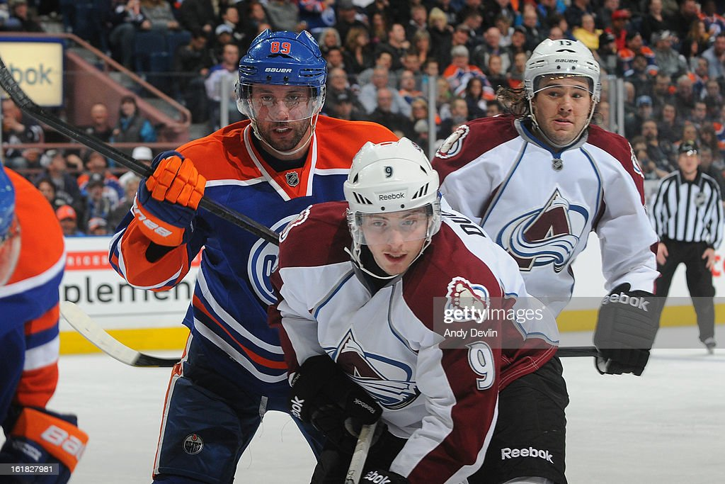 <a gi-track='captionPersonalityLinkClicked' href=/galleries/search?phrase=Sam+Gagner&family=editorial&specificpeople=4042961 ng-click='$event.stopPropagation()'>Sam Gagner</a> #89 of the Edmonton Oilers battles for postion against <a gi-track='captionPersonalityLinkClicked' href=/galleries/search?phrase=Matt+Duchene&family=editorial&specificpeople=4819304 ng-click='$event.stopPropagation()'>Matt Duchene</a> #9 of the Colorado Avalanche on February 16, 2013 at Rexall Place in Edmonton, Alberta, Canada.