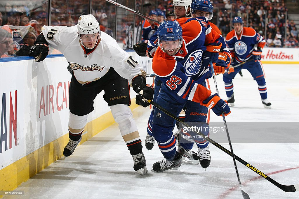 <a gi-track='captionPersonalityLinkClicked' href=/galleries/search?phrase=Sam+Gagner&family=editorial&specificpeople=4042961 ng-click='$event.stopPropagation()'>Sam Gagner</a> #89 of the Edmonton Oilers battles for the puck against <a gi-track='captionPersonalityLinkClicked' href=/galleries/search?phrase=Corey+Perry&family=editorial&specificpeople=213864 ng-click='$event.stopPropagation()'>Corey Perry</a> #10 of the Anaheim Ducks on April 22, 2013 at Rexall Place in Edmonton, Alberta, Canada.