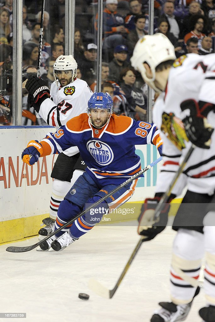 <a gi-track='captionPersonalityLinkClicked' href=/galleries/search?phrase=Sam+Gagner&family=editorial&specificpeople=4042961 ng-click='$event.stopPropagation()'>Sam Gagner</a> #89 of the Edmonton Oilers battles for the puck against <a gi-track='captionPersonalityLinkClicked' href=/galleries/search?phrase=Johnny+Oduya&family=editorial&specificpeople=3944055 ng-click='$event.stopPropagation()'>Johnny Oduya</a> #27 of the Chicago Blackhawks on April 24, 2013 at Rexall Place in Edmonton, Alberta, Canada.