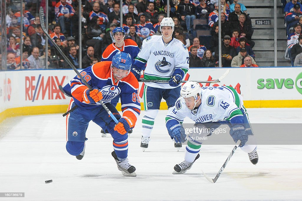 <a gi-track='captionPersonalityLinkClicked' href=/galleries/search?phrase=Sam+Gagner&family=editorial&specificpeople=4042961 ng-click='$event.stopPropagation()'>Sam Gagner</a> #89 of the Edmonton Oilers battles for the puck against <a gi-track='captionPersonalityLinkClicked' href=/galleries/search?phrase=Jordan+Schroeder&family=editorial&specificpeople=4450940 ng-click='$event.stopPropagation()'>Jordan Schroeder</a> #45 of the Vancouver Canucks on February 4, 2013 at Rexall Place in Edmonton, Alberta, Canada.