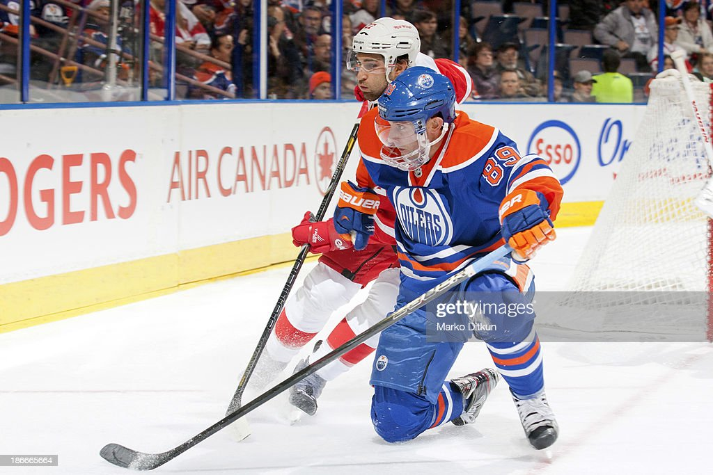 <a gi-track='captionPersonalityLinkClicked' href=/galleries/search?phrase=Sam+Gagner&family=editorial&specificpeople=4042961 ng-click='$event.stopPropagation()'>Sam Gagner</a> #89 of the Edmonton Oilers battles for the puck against <a gi-track='captionPersonalityLinkClicked' href=/galleries/search?phrase=Kyle+Quincey&family=editorial&specificpeople=2234340 ng-click='$event.stopPropagation()'>Kyle Quincey</a> #27 of the Detroit Red Wings on November 2, 2013 at Rexall Place in Edmonton, Alberta, Canada.
