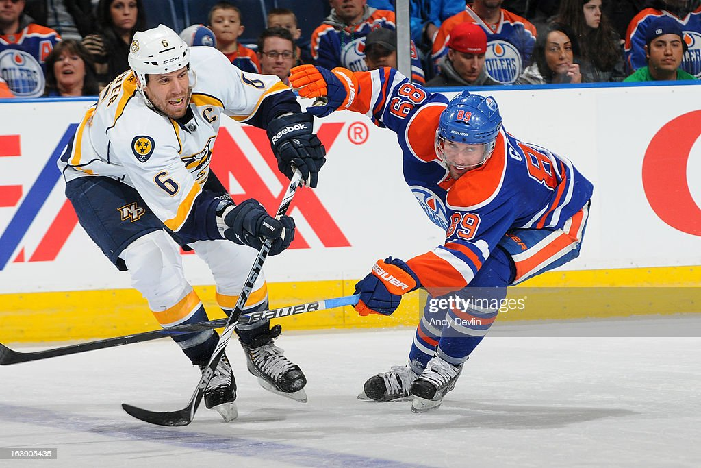 Sam Gagner #89 of the Edmonton Oilers battles for the puck against Shea Weber #6 of the Nashville Predators on March 17, 2013 at Rexall Place in Edmonton, Alberta, Canada.