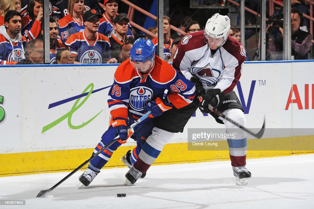 <a gi-track='captionPersonalityLinkClicked' href=/galleries/search?phrase=Sam+Gagner&family=editorial&specificpeople=4042961 ng-click='$event.stopPropagation()'>Sam Gagner</a> #89 of the Edmonton Oilers battles for the puck with <a gi-track='captionPersonalityLinkClicked' href=/galleries/search?phrase=Jan+Hejda&family=editorial&specificpeople=624333 ng-click='$event.stopPropagation()'>Jan Hejda</a> #8 of the Colorado Avalanche during the NHL game at Rexall Place on February 16, 2013 in Edmonton, Alberta, Canada. Oilers won 6-4.