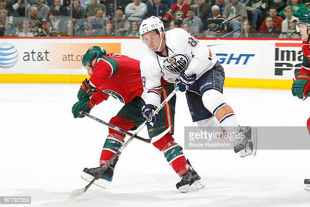 Sam Gagner of the Edmonton Oilers collides with Greg Zanon of the Minnesota Wild during the game at the Xcel Energy Center on March 16 2010 in Saint...