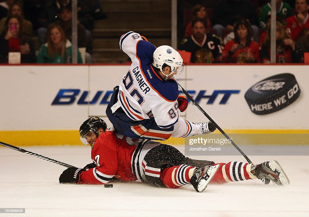 <a gi-track='captionPersonalityLinkClicked' href=/galleries/search?phrase=Sam+Gagner&family=editorial&specificpeople=4042961 ng-click='$event.stopPropagation()'>Sam Gagner</a> #89 of the Edmonton Oilers falls over <a gi-track='captionPersonalityLinkClicked' href=/galleries/search?phrase=Johnny+Oduya&family=editorial&specificpeople=3944055 ng-click='$event.stopPropagation()'>Johnny Oduya</a> #27 of the Chicago Blackhawks at the United Center on February 25, 2013 in Chicago, Illinois.