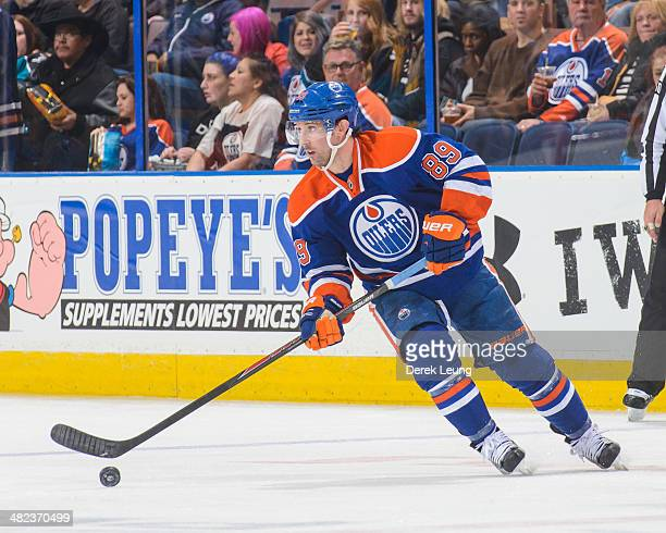 Sam Gagner of the Edmonton Oilers in action against the San Jose Sharks during an NHL game at Rexall Place on March 25 2014 in Edmonton Alberta Canada