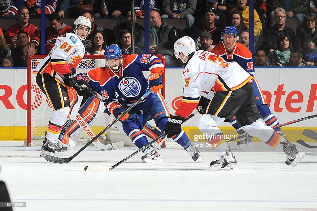 <a gi-track='captionPersonalityLinkClicked' href=/galleries/search?phrase=Sam+Gagner&family=editorial&specificpeople=4042961 ng-click='$event.stopPropagation()'>Sam Gagner</a> #89 of the Edmonton Oilers prepares to block a shot taken by Ladislav Smid #3 of the Calgary Flames on March 22, 2014 at Rexall Place in Edmonton, Alberta, Canada.