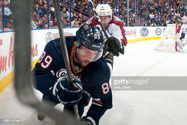 Sam Gagner of the Edmonton Oilers races for the puck in the corner while Ryan O'Byrne of the Colorado Avalanche defends at Rexall Place on February...