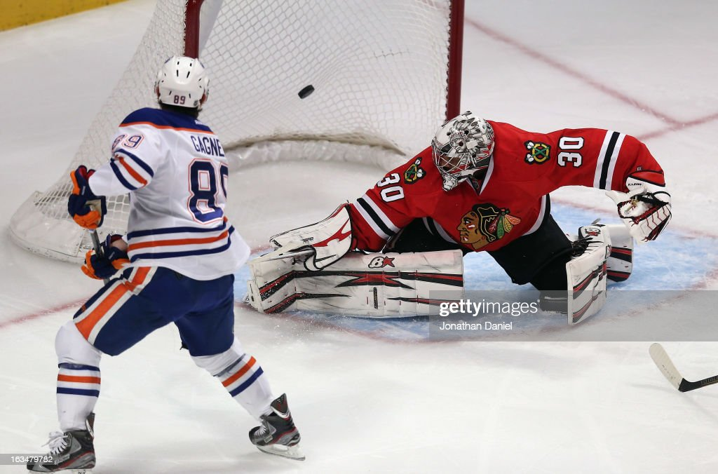 <a gi-track='captionPersonalityLinkClicked' href=/galleries/search?phrase=Sam+Gagner&family=editorial&specificpeople=4042961 ng-click='$event.stopPropagation()'>Sam Gagner</a> #89 of the Edmonton Oilers scores a 1st period goal against <a gi-track='captionPersonalityLinkClicked' href=/galleries/search?phrase=Ray+Emery&family=editorial&specificpeople=218109 ng-click='$event.stopPropagation()'>Ray Emery</a> #30 of the Chicago Blackhawks at the United Center on March 10, 2013 in Chicago, Illinois.