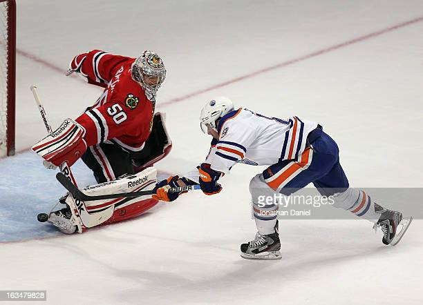 Sam Gagner of the Edmonton Oilers scores a power play goal against Corey Crawford of the Chicago Blackhawks at the United Center on March 10 2013 in...