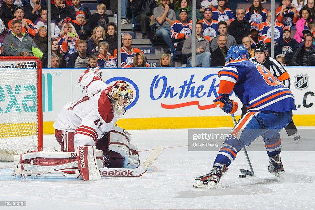 <a gi-track='captionPersonalityLinkClicked' href=/galleries/search?phrase=Sam+Gagner&family=editorial&specificpeople=4042961 ng-click='$event.stopPropagation()'>Sam Gagner</a> #89 of the Edmonton Oilers scores on Mike Smith #41 of the Minnesota Wild during shoot-out at Rexall Place on February 23, 2013 in Edmonton, Alberta, Canada.