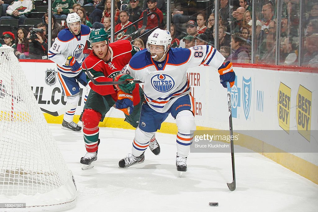 <a gi-track='captionPersonalityLinkClicked' href=/galleries/search?phrase=Sam+Gagner&family=editorial&specificpeople=4042961 ng-click='$event.stopPropagation()'>Sam Gagner</a> #89 of the Edmonton Oilers skates with the puck while <a gi-track='captionPersonalityLinkClicked' href=/galleries/search?phrase=Kyle+Brodziak&family=editorial&specificpeople=2165412 ng-click='$event.stopPropagation()'>Kyle Brodziak</a> #21 of the Minnesota Wild defends during the game on March 3, 2013 at the Xcel Energy Center in Saint Paul, Minnesota.