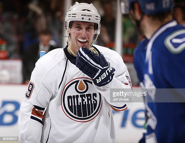 Sam Gagner of the Edmonton Oilers talks to Ryan Kesler of the Vancouver Canucks during their game at General Motors Place on October 25 2009 in...
