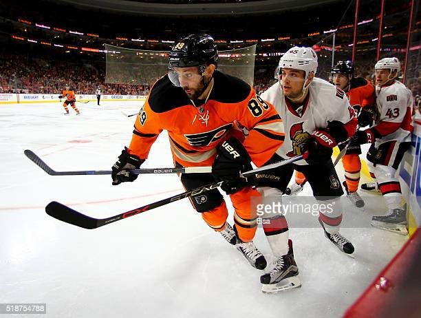 Sam Gagner of the Philadelphia Flyers and Chris Wideman of the Ottawa Senators fight for position in the second period at the Wells Fargo Center on...