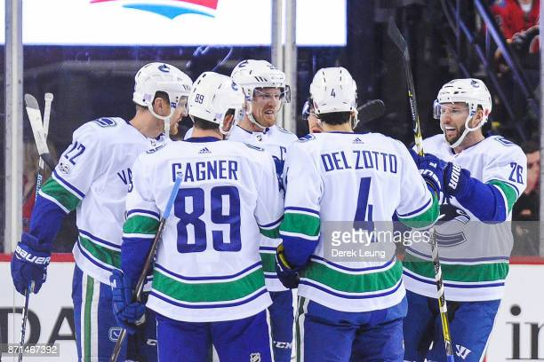 Sam Gagner of the Vancouver Canucks celebrates with his teammates after scoring against the Calgary Flames during an NHL game at Scotiabank...