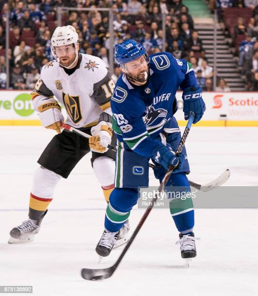 Sam Gagner of the Vancouver Canucks fires a shot on net while being defended against by James Neal of the Vegas Golden Knights in NHL action on...