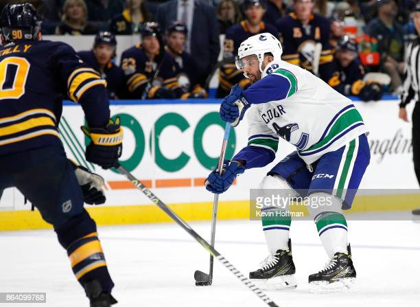 Sam Gagner of the Vancouver Canucks shoots the puck as Ryan O'Reilly of the Buffalo Sabres defends during the third period at the KeyBank Center on...