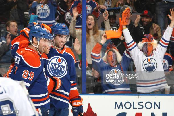 Sam Gagner Taylor Hall and Justin Schultz of the Edmonton Oilers celebrate after a goal in a game against the Tampa Bay Lightning on January 5 2014...