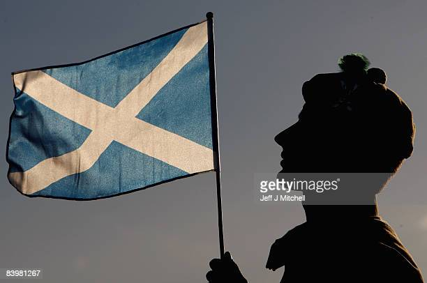 Sam Galloway of the Argyll and Sutherland Highlanders stands with a Saltire flag during the home coming parade on December 10 2008 in Stirling...