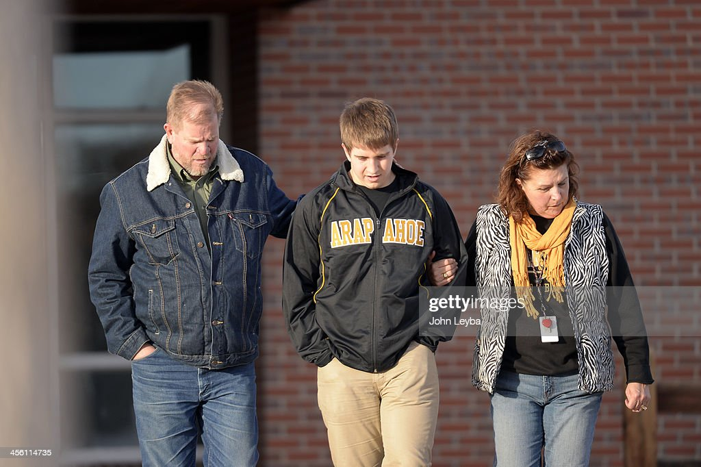 CENTENNIAL, CO - Sam Gardinier, Jr at Arapahoe High School leaves Euclid Middle School with his parents Tom and Chris Gardinier after getting bused their from Arapahoe High School December 13, 2013. A gunman at the school was targeting a teacher at the school. The gunman shot two students in the process and then turned the gun on himself.