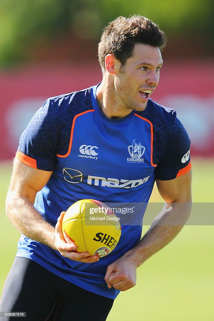 Sam Gibson of the Kangaroos handballs during a North Melbourne Kangaroos AFL media session at Arden Street Ground on May 5, 2016 in Melbourne, Australia.