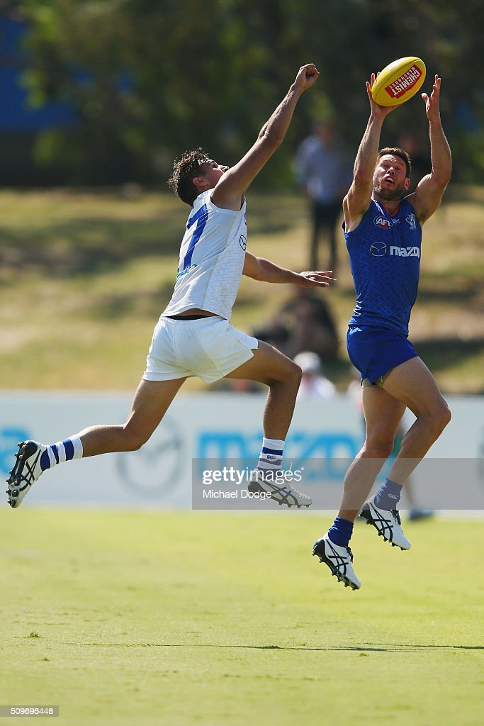 Sam Gibson of the Kangaroos marks the ball during the North Melbourne AFL Intra-Club match at Arden Street Ground on February 12, 2016 in Melbourne, Australia.