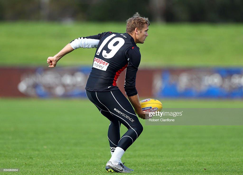 Sam Gilbert of the Saints handballs during a St Kilda Saints AFL training session at Moorabbin Oval on May 27, 2016 in Melbourne, Australia.
