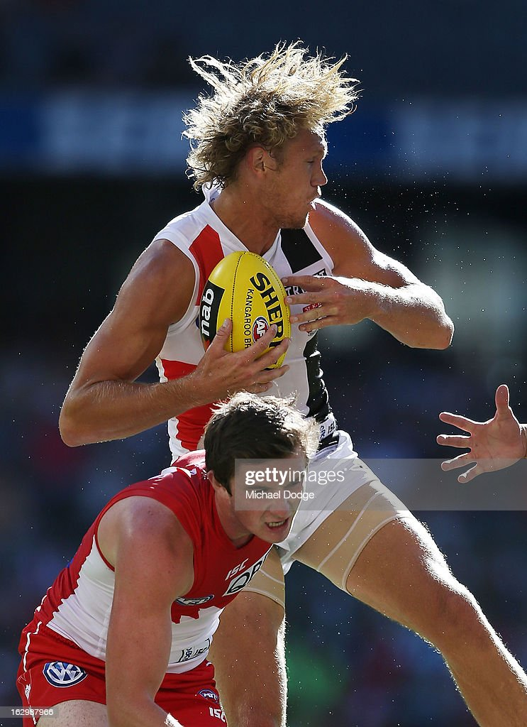 Sam Gilbert (top) of the St.Kilda Saints and Andrejs Everitt contest for the ball during the round two AFL NAB Cup match between the St Kilda Saints and the Sydney Swans at Etihad Stadium on March 3, 2013 in Melbourne, Australia.
